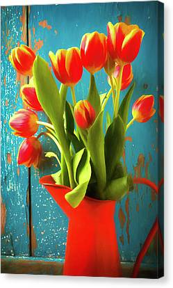 Orange Pitcher With Tulips Canvas Print by Garry Gay