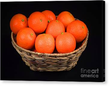 Oranges In A Basket Canvas Print by Ray Shrewsberry