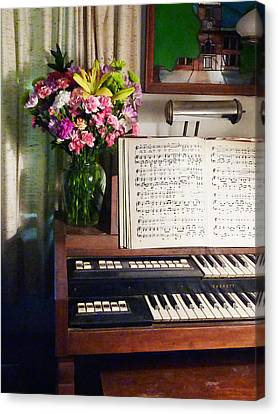 Organ And Bouquet Of Flowers Canvas Print by Susan Savad