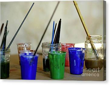 Paintbrushes Soaking In Water Canvas Print by Sami Sarkis