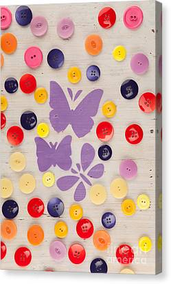Painted Butterflies In A Meadow Of Buttons Canvas Print by Wolfgang Steiner