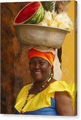 Palenquera In Cartagena Colombia Canvas Print by Anna Smith