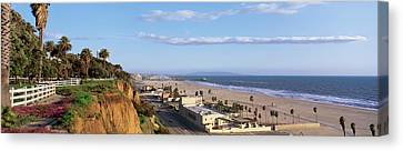 Panorama View Of Beach And Blue Sky Canvas Print by Panoramic Images