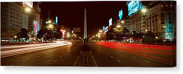 Panoramic View At Night Of Avenida 9 De Canvas Print by Panoramic Images