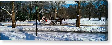 Panoramic View Of Snowy City Street Canvas Print by Panoramic Images