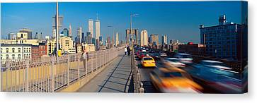 Panoramic View Of Speeding Taxis Canvas Print by Panoramic Images