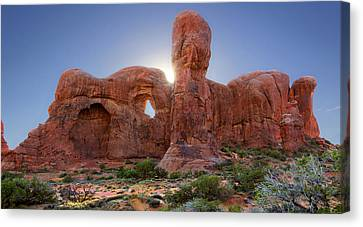 Parade Of Elephants In Arches National Park Canvas Print by Mike McGlothlen