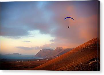 Paragliding In Paradise Canvas Print by Mountain Dreams
