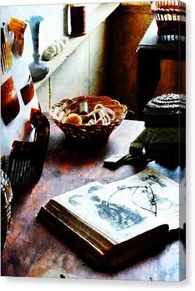Pattern Book Canvas Print by Susan Savad