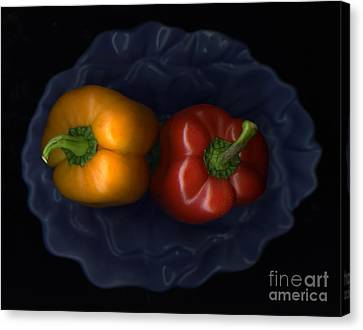 Peppers And Blue Bowl Canvas Print by Christian Slanec