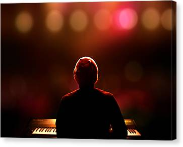 Pianist On Stage From Behind Canvas Print by Johan Swanepoel