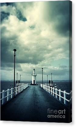 Pier And Lighthouse Canvas Print by Carlos Caetano