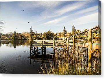Piers And Peaceful Blue Waters Canvas Print by Jorgo Photography - Wall Art Gallery