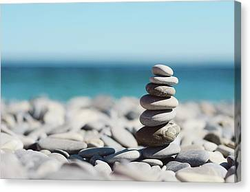 Pile Of Stones On Beach Canvas Print by Dhmig Photography