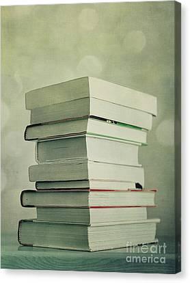 Piled Reading Matter Canvas Print by Priska Wettstein