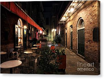 Pirates Alley At Night Canvas Print by John Rizzuto