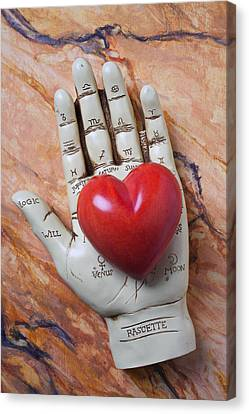 Plam Reader Hand Holding Red Stone Heart Canvas Print by Garry Gay