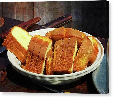 Plate With Sliced Bread And Knives Canvas Print by Susan Savad