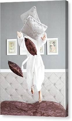 Playful Young Woman Jumping On The Bed , A Pillow Fight Canvas Print by Jenya Pavlovski
