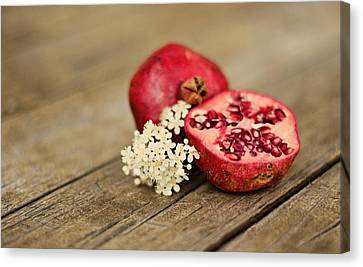 Pomegranate And Flowers On Tabletop Canvas Print by Anna Hwatz Photography Find Me On Facebook