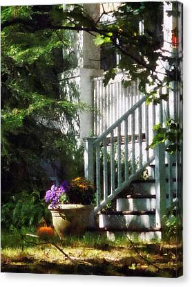 Porch With Urn And Pumpkin Canvas Print by Susan Savad