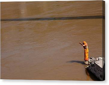 Praying On  Banks Of Holy Ganges In Rishike Canvas Print by Claude Renault