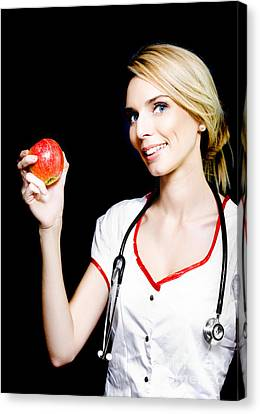 Pretty Nurse Shows The Benefits Of Eating Properly Canvas Print by Jorgo Photography - Wall Art Gallery