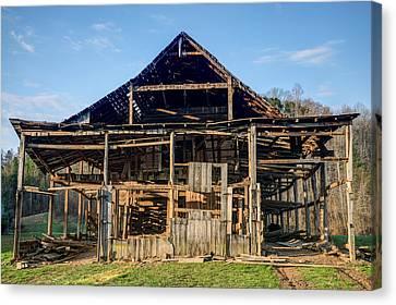 Primative Barn Being Dismantled Canvas Print by Douglas Barnett