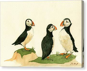 Puffins Canvas Print by Juan  Bosco