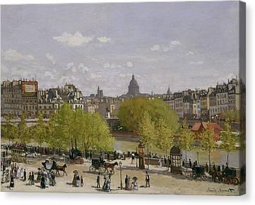 Quai Du Louvre In Paris Canvas Print by Claude Monet