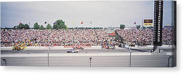 Racecars On A Motor Racing Track Canvas Print by Panoramic Images