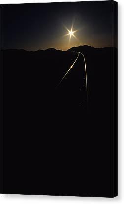 Rails At Sunrise Canvas Print by Susan  Benson