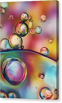 Rainbow Bubble Drops Canvas Print by Sharon Johnstone