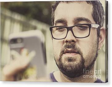 Real Life Bearded Hipster Using Smart Phone Canvas Print by Jorgo Photography - Wall Art Gallery