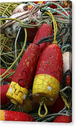 Red And Yellow Buoys Canvas Print by Carol Leigh