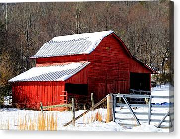 Red Barn In Snow Canvas Print by Carol R Montoya