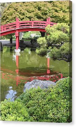 Red Bridge Reflection Canvas Print by Carol Groenen