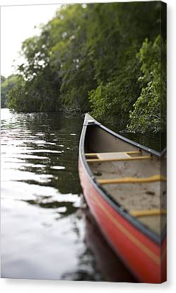 Red Canoe At Shoreline With Trees Canvas Print by Gillham Studios