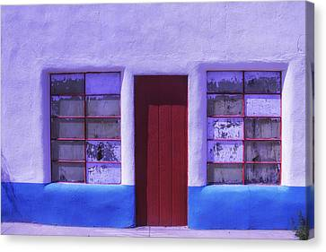 Red Door Old Building Canvas Print by Garry Gay