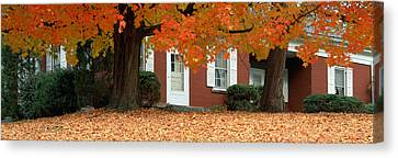Red House And Maple Trees Along Route Canvas Print by Panoramic Images