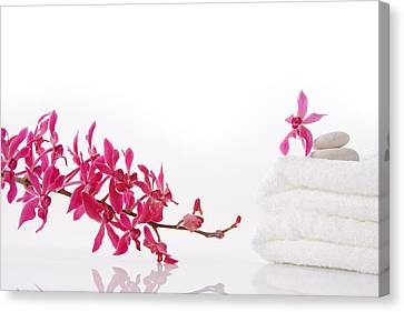 Red Orchid With Towel Canvas Print by Atiketta Sangasaeng