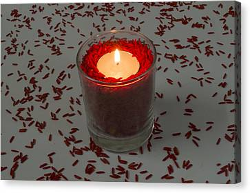 Red Rice Candle Canvas Print by Mohammed Mostafa