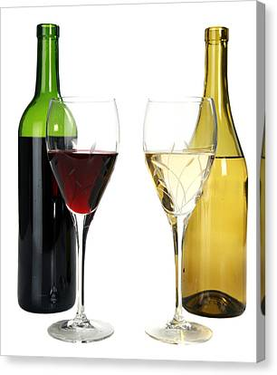 Red Wine And White Wine In Cut Crystal Wine Glasses  Canvas Print by Michael Ledray