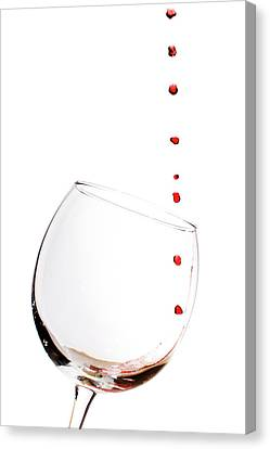 Red Wine Drops Into Wineglass Canvas Print by Dustin K Ryan