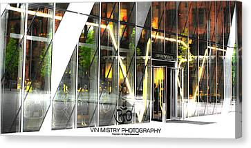 Reflection  Armani Manchester Canvas Print by Vin Mistry