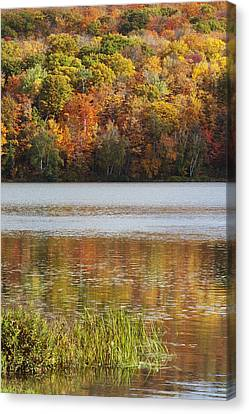 Reflection Of Autumn Colors In A Lake Canvas Print by Susan Dykstra