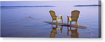 Reflection Of Two Adirondack Chairs Canvas Print by Panoramic Images