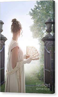 Regency Woman Looking Through A Gateway Canvas Print by Lee Avison
