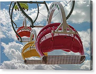 Ride Against The Sky Canvas Print by John Haldane