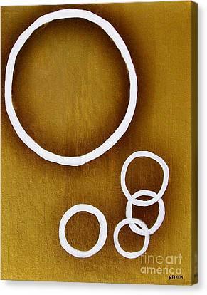 Rings On Gold Canvas Print by Marsha Heiken